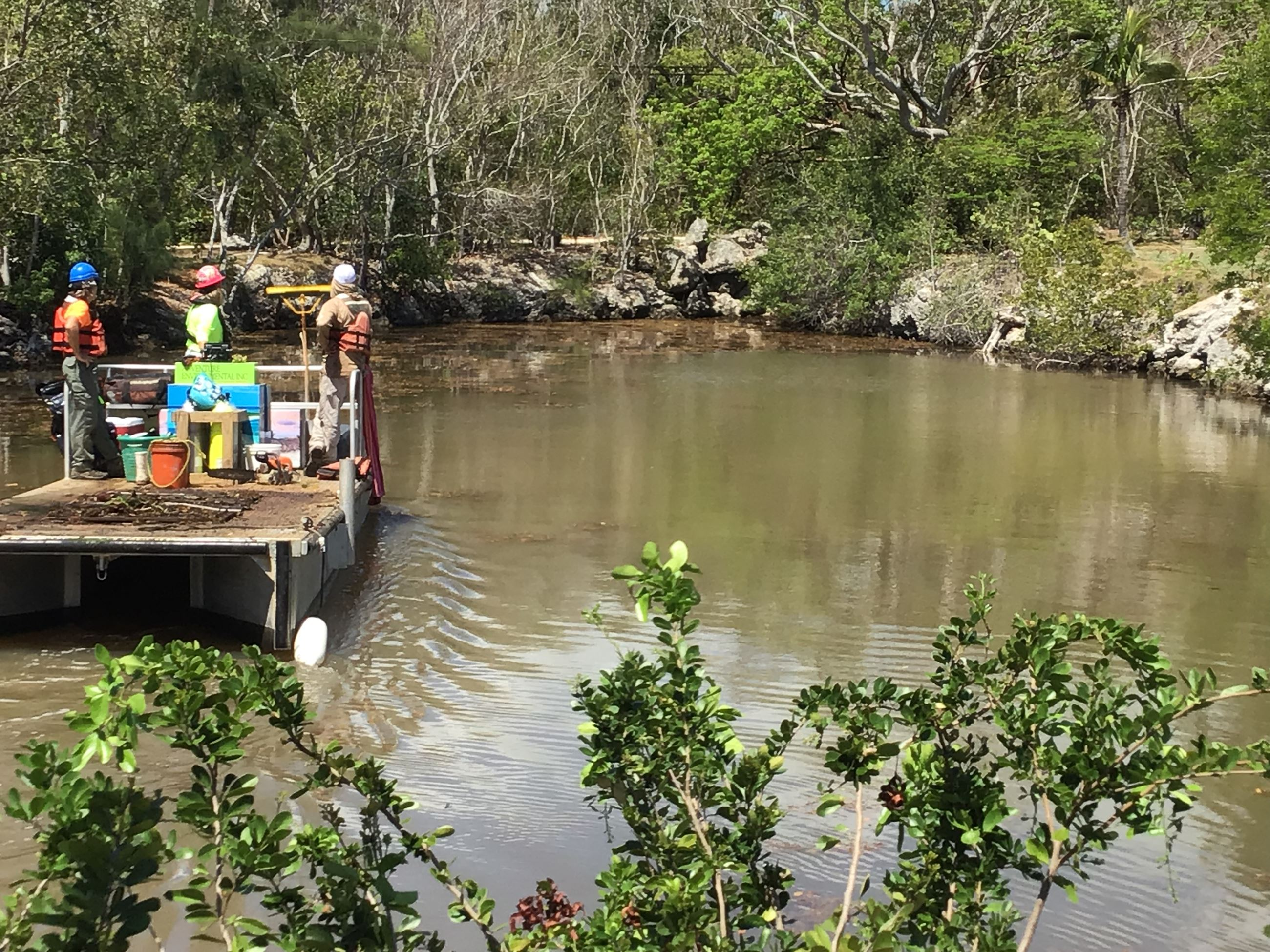 A canal is cleaned in Key Largo as part of the project.