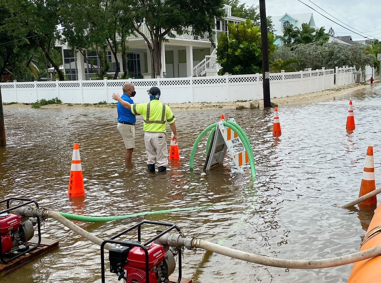 Roman Gastesi stands in water on the road in Key Largo looking at the flooding