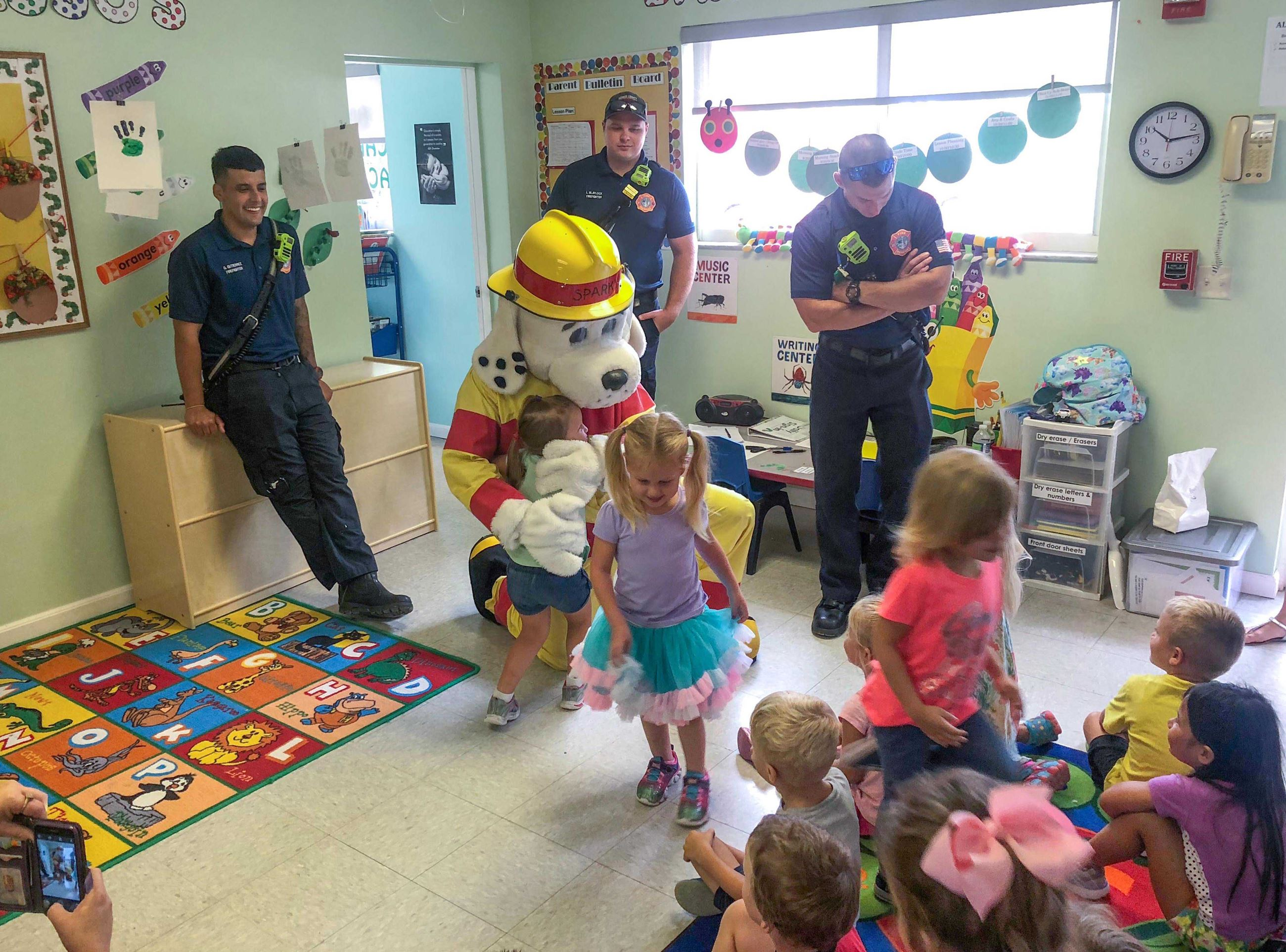 Photo of Monroe County Fire Rescue crew and mascot Sparky teaching fire prevention to children at Ba